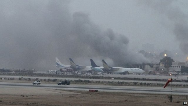 Smoke billows from Karachi airport (9 June 2014)