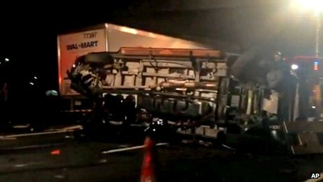 The limousine bus that had carried Tracy Morgan and six other people lies on its side on the New Jersey Turnpike