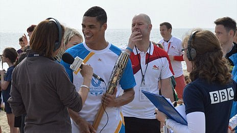Antony Ogogo on Lowestoft beach with BBC Radio Suffolk