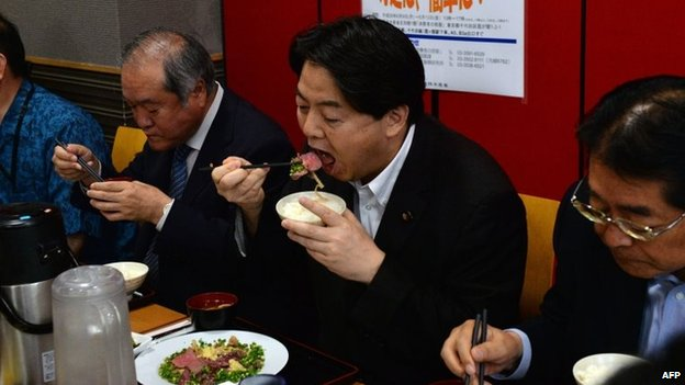 Japanese Agriculture Minister Yoshimasa Hayashi (2nd R), during an event to promote whale meat