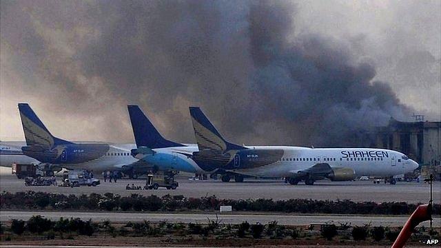 Smoke rises at Jinnah International Airport in Karachi