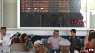 Passengers of Karachi-bound Pakistan International Airline (PIA) flights wait after delays at the Benazir Bhutto International Airport in Islamabad