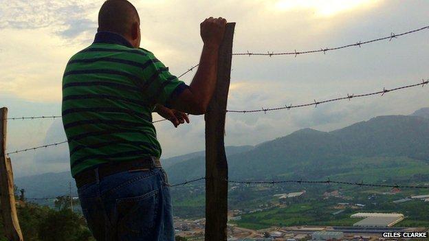 Activist Erick Fernando Castillo Perez looks down at the Escobal silver mine