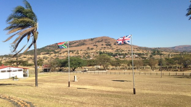 South African flag alongside the British flag at Rorke Drift