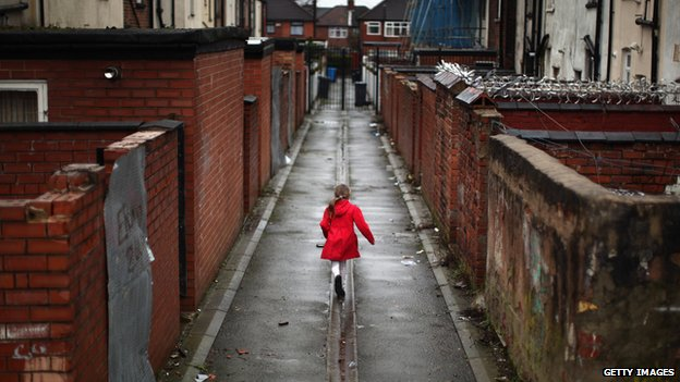 Child runs through run down area of Manchester