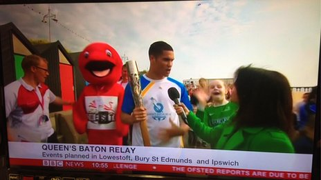 Anthony Ogogo carrying the baton in Lowestoft