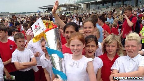 School children at Newmarket Racecourse for the Queen's Baton Relay