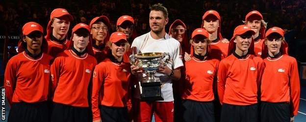 Stanislas Wawrinka celebrates his Australian Open win with the ball boys and girls