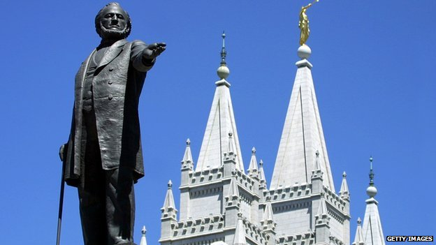 A statue of Brigham Young, an early leader of the Mormon Church, stands in front of the Mormon Temple in Salt Lake City, Utah.