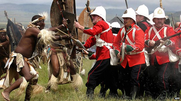 A group in British uniforms is assailed by Zulu warriors during the 125th Anniversary re-enactment of the battle of Isandlwana some 350 kilometres north of Durban on 24 January 2004.