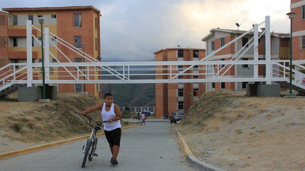 Boy walking with his bike in Ciudad Caribia