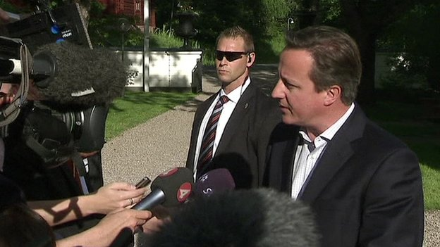 David Cameron speaking to the media in Sweden