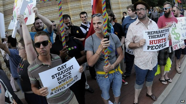 Gay rights activists protest outside the Texas Republican Convention on 5 June, 2014.