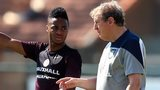England winger Raheem Sterling in training with manager Roy Hodgson