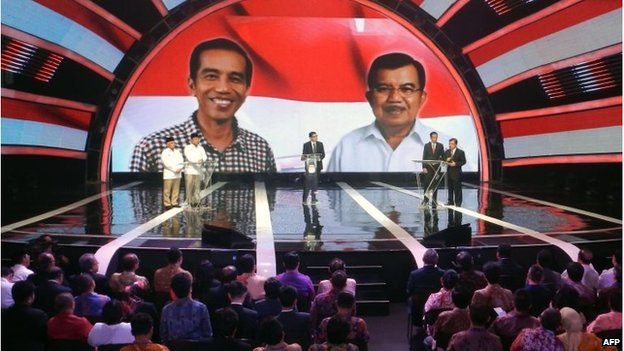 The candidates answer questions during a live television debate in Jakarta on June 9