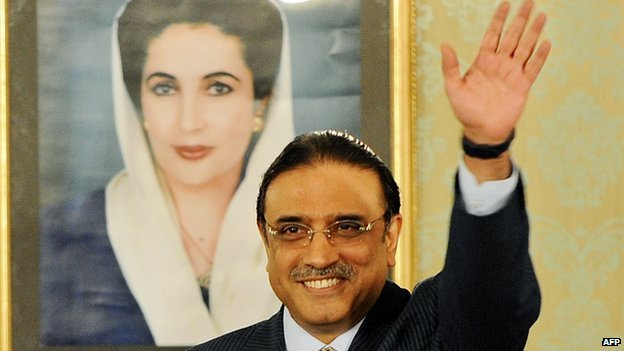 President Asif Ali Zardari with portrait of Benazir Bhutto