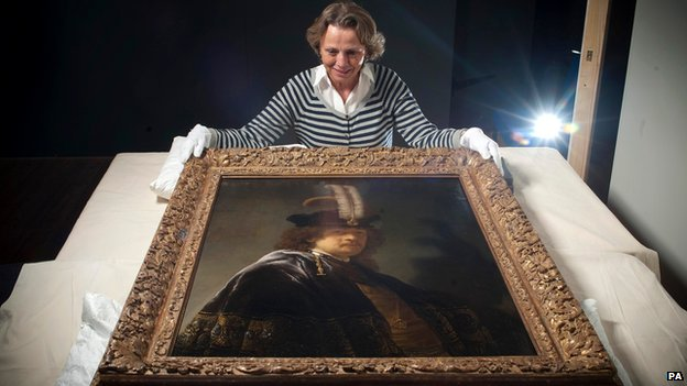 Tina Sitwell, Paintings conservation advisor, looking at the self-portrait of Rembrandt