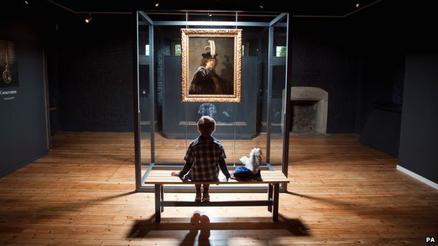 Young boy examining Rembrandt painting