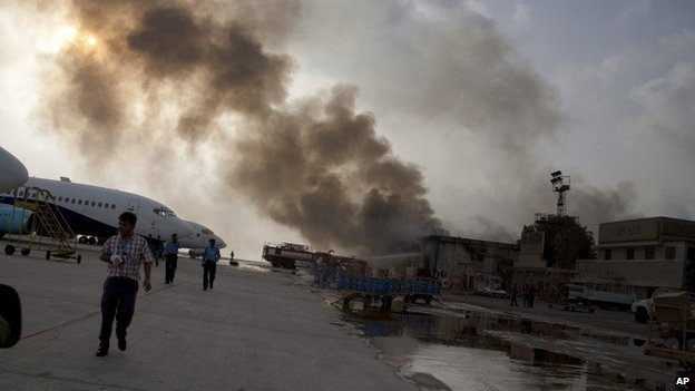 Smoke rises above the Jinnah International Airport where security forces battled militants Monday, June 9, 2014, in Karachi, Pakistan.