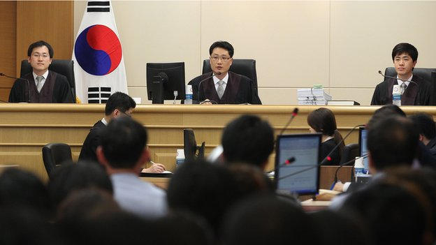 Judges sit to preside over a pretrial hearing of crew members of the sunken ferry Sewol at Gwangju District Court in Gwangju, South Korea, on Tuesday, 10 June, 2014