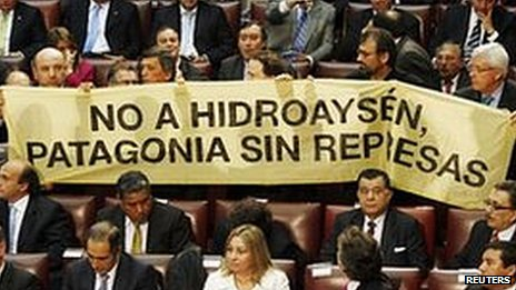 Opposition deputies hold up a placard in protest against the dam during President Sebastian Pinera's annual address at the national congress building in Valparaiso city on 21 May, 2011