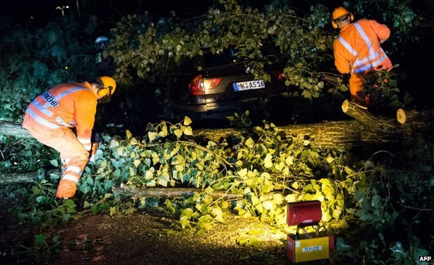 Firefighters remove tree from car in Duesseldorf