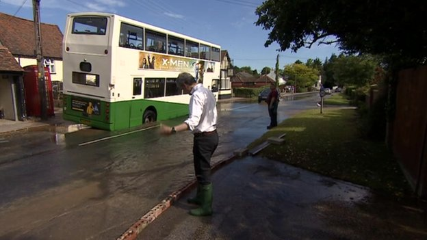 Ipswich Road in Holbrook, with bus in water