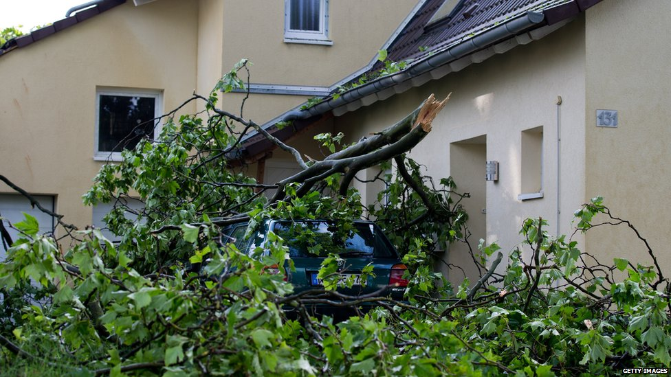 Broken branches lie on a car in Neuss, Germany. 10 June 2014