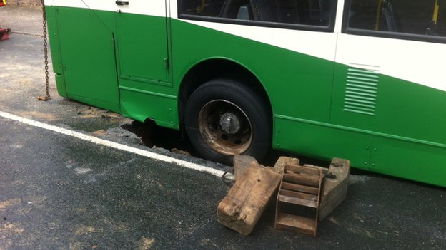Double decker bus stuck in hole in Holbrook