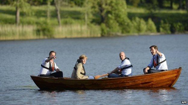 British Prime Minister David Cameron, German Chancellor Angela Merkel, Swedish Prime minister Fredrik Reinfeldt and Dutch Prime Minister Mark Rutte talk in a boat
