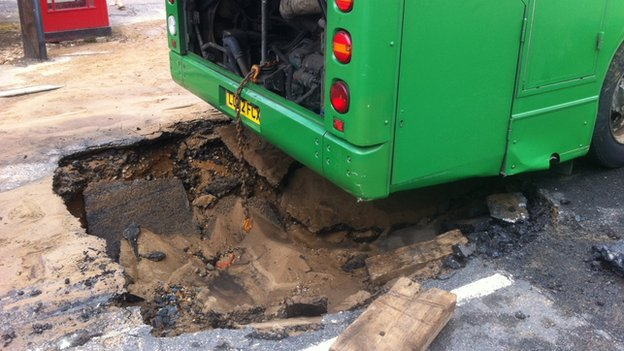 Bus stuck in a hole in Holbrook
