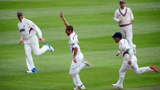 Somerset's Alfonso Thomas celebrates taking a wicket