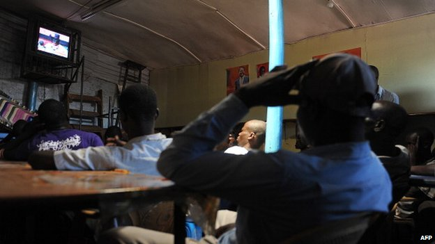 Kenyans watching television in Kibera, Nairobi - March 2013