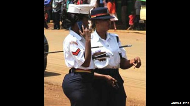 A photograph of Kenyan police officer Linda Okello wearing a tight skirt, which proved controversial