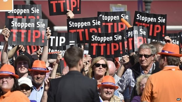 People protest against the Transatlantic Trade and Investment Partnership (TTIP) with the US at the final election party of the Christian Democratic Union on 23 May 2014