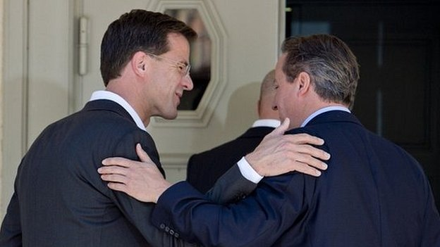 David Cameron embraces Dutch prime minister Mark Rutte after Tuesday's press conference
