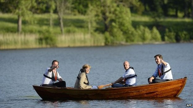 The four leaders take a trip in a rowing boat at the summer residence of Swedish prime minister Fredrik Reinfeldt