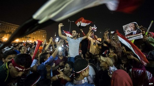Egyptians celebrate in Tahrir Square in Cairo after Abdel Fattah al-Sisi won Egypt's presidential election - 3 June 2014