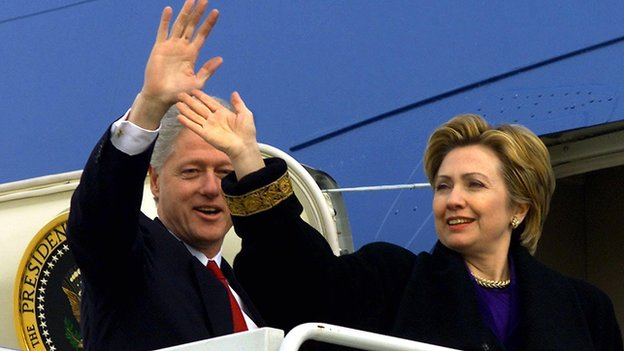 Bill and Hillary Clinton wave from Air Force One on 7 January, 2001.