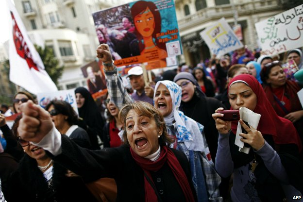 Egyptians chant slogans as they march in downtown Cairo to mark International Women's Day - 8 March 2013