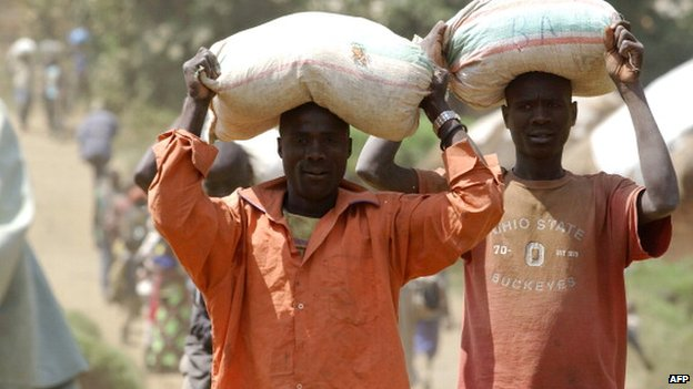 Men carry bags of minerals from the Mudere mine, eastern DR Congo - May 2013