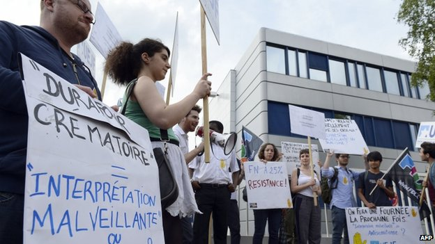 Activists demonstrate in front of the headquarters of the National Front party in Nanterre on 9 June 2014