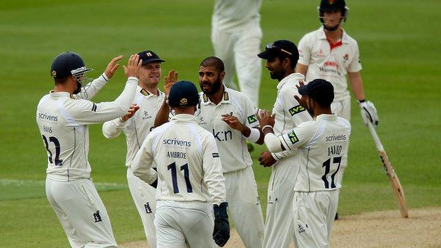 Warwickshire's players celebrate  a Jeetan Patel wicket against Lancashire at Edgbaston