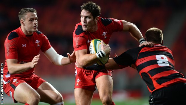 James Hook of Wales is tackled by Paul Schoemnan