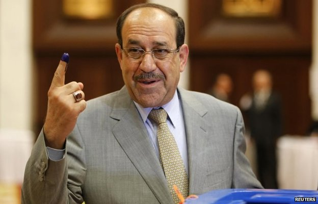 Nouri Maliki has his finger marked with ink after voting in the April 2014 parliamentary election
