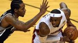 Miami Heat's LeBron James (right) was outscored by San Antonio Spurs's Kawhi Leonard (left)