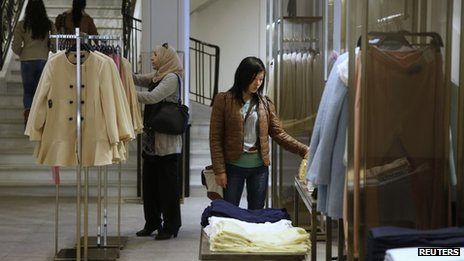 Women look at clothes inside a Zara store