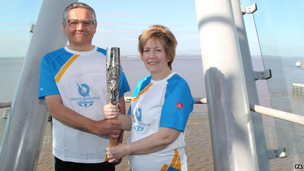 Patrick Revell and Julie Williams with the baton