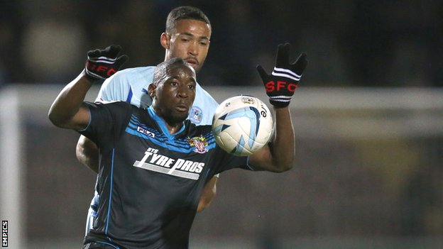 Stevenage's Lucas Akins controls the ball against Coventry