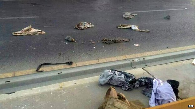 A picture taken with a mobile phone shows uniforms reportedly belonging to Iraqi security forces scattered on the road on June 10, 2014
